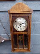 1930's wall clock in oak case