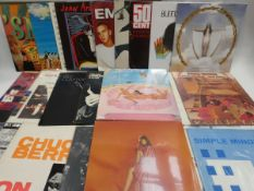 Box containing quantity of LP and 45 records to include Kiss, The Killers, Stevie Wonder and