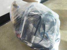 Bag containing a mix of electrical sundries cabling, chargers and other accessories
