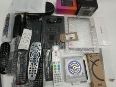 Bag containing remote controls, Echo Dot, Paker Pen, guitar strings, mini 4G WiFi, Flexon Desk Stand