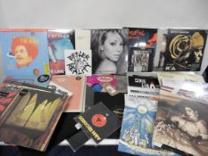 A mixed lot of Vinyl, LPs Singles, and Elvis 78, Harry Styles, Madonna, Shaggy, Warpaint etc