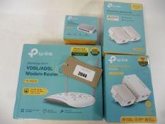 bag of Tp-Link 300 Mbps Wifi VDSL/ADSL Router TD-W9970, 2 Tp-link AV600 Powerline wi-fi kits & tp-