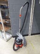 (TN100) Henry micro vacuum cleaner with pole and small bag of accessories
