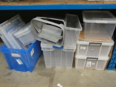 Approximately 8 plastic storage containers and lids. Various sizes