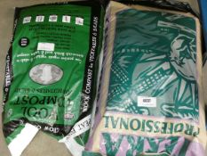 Bag of wool compost and bag of terror compost