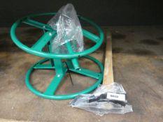 Splitting axe and green hose reel