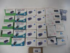 bag of 31 fingertip pulse oximeters, various makes.