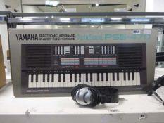 Yamaha electronic keyboard in box with stand and headphones Item is used, includes PSU