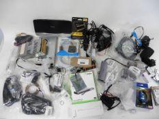 A bag of various adaptors, cables, psu's, components etc.
