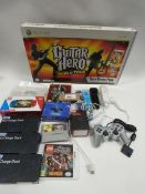 Bag containing Xbox 360 Guitar Hero (no game), Wii controllers, 3x Orzly duo-charge docks,