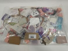 Bag of loose costume and dress jewellery items.