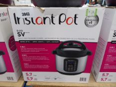 (TN20) Instant Pot multi use pressure cooker with box
