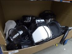 Box containing mixed kitchen appliances, instant pot, coffee machines, kettle, etc