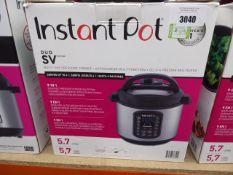 (TN22) Instant Pot multi use pressure cooker with box