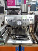 Unboxed Sage Barista Express coffee machine with milk jug and spoon