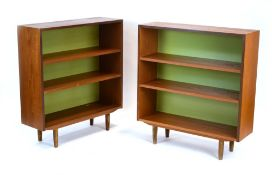 A pair of 1970's G-Plan teak open bookcases on turned legs, w.