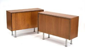 A pair of G-Plan teak low cabinets, each with a pair of doors on later spun aluminium legs, w.