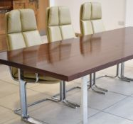 A 1970's rosewood boardroom/dining table,