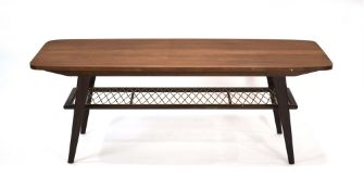 A 1960's Danish teak coffee table, the curved rectangular surface over a wicker criss-cross tier,
