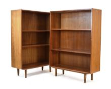 A pair of 1960's Danish teak open adjustable bookcases on turned beech legs, w.