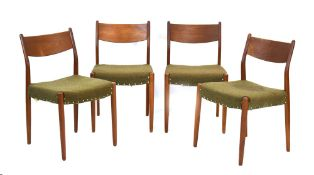 A set of four 1960's Danish teak bar back dining chairs with studded upholstery,