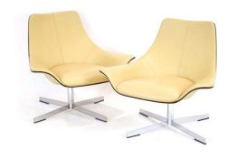 A pair of Matteo Grassi 2Leather cream lowback armchairs on four-star aluminium swivel bases *Sold