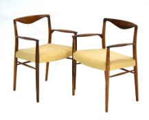 Kai Lyngfeldt for Soren Willadsen, a pair of 1960's Danish rosewood elbow armchairs of organic form,