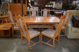 Ercol elm refectory style dining table and 6 chairs incl. pair of carvers Water damage, especially