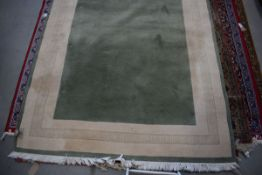 5320 Large carpet in green and cream ground with Grecian style border, approx 200 x 250cm