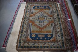 (16) Afghanistan hand woven carpet in shades of brown, cream and blue depicting geometric motifs,
