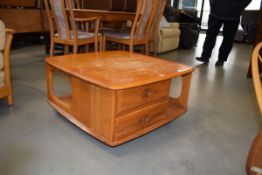 Ercol elm coffee table of square form with drawers under in need of some attention. Varnish on