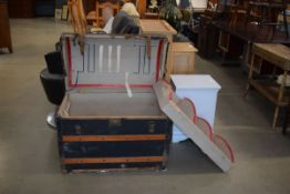 Dome top and wooden bound cabin trunk containing selection of Elizabeth George and other novels