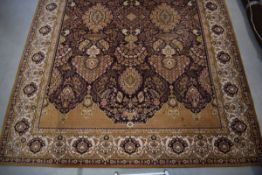 (12) A Remstaler Kerima carpet in shades of brown and mustard with foliate motifs approx. 250 x