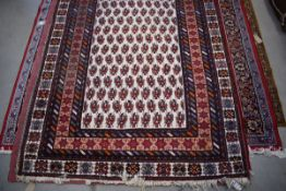 (14) Afghanistan wool carpet with white ground and red border and geometric motifs approx. 190 x