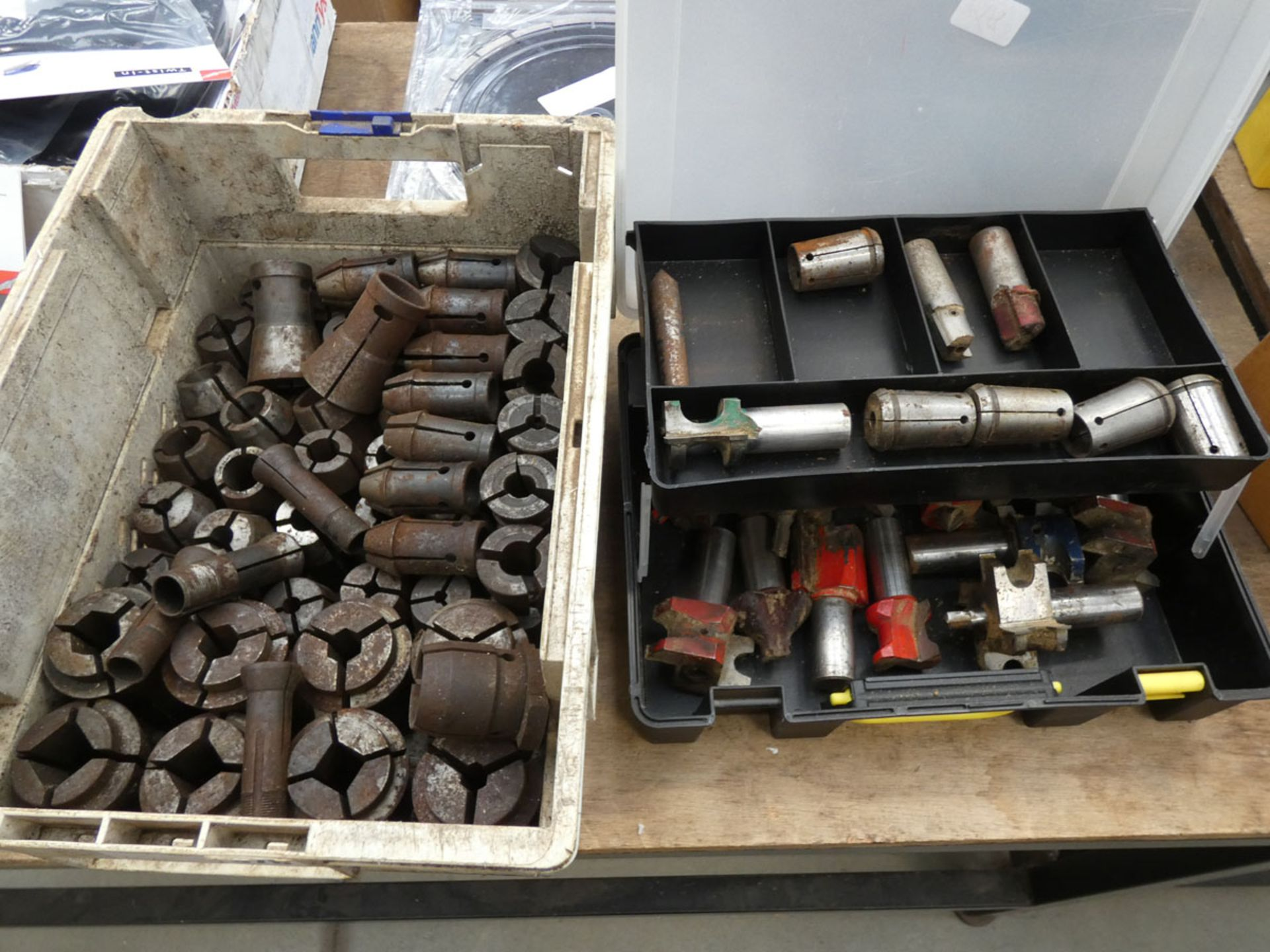 2 boxes of collets and large router bit cutters
