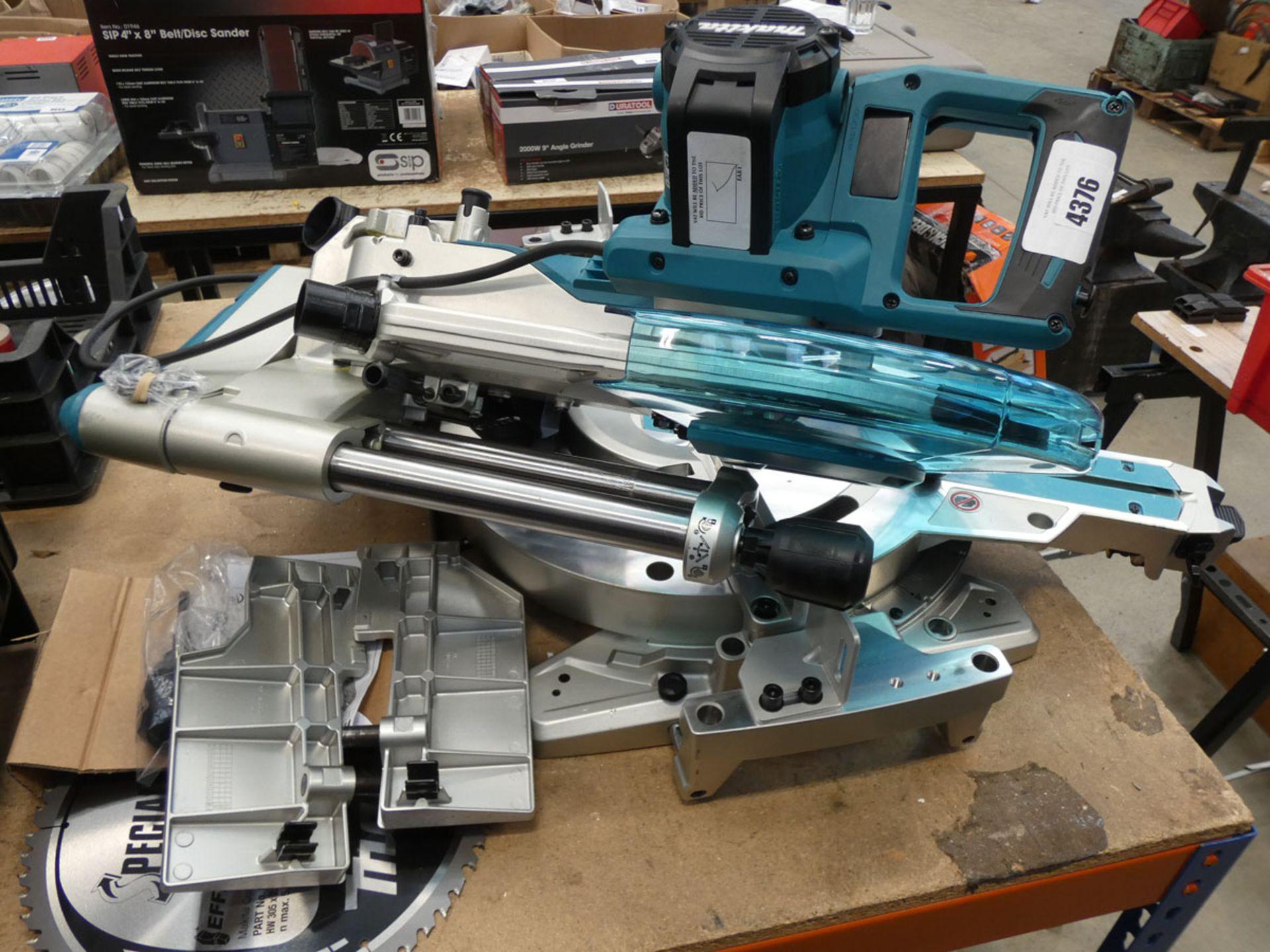 Makita DPX chop saw in 4 parts Broken handle and wires showing. Broken tilting mechanism
