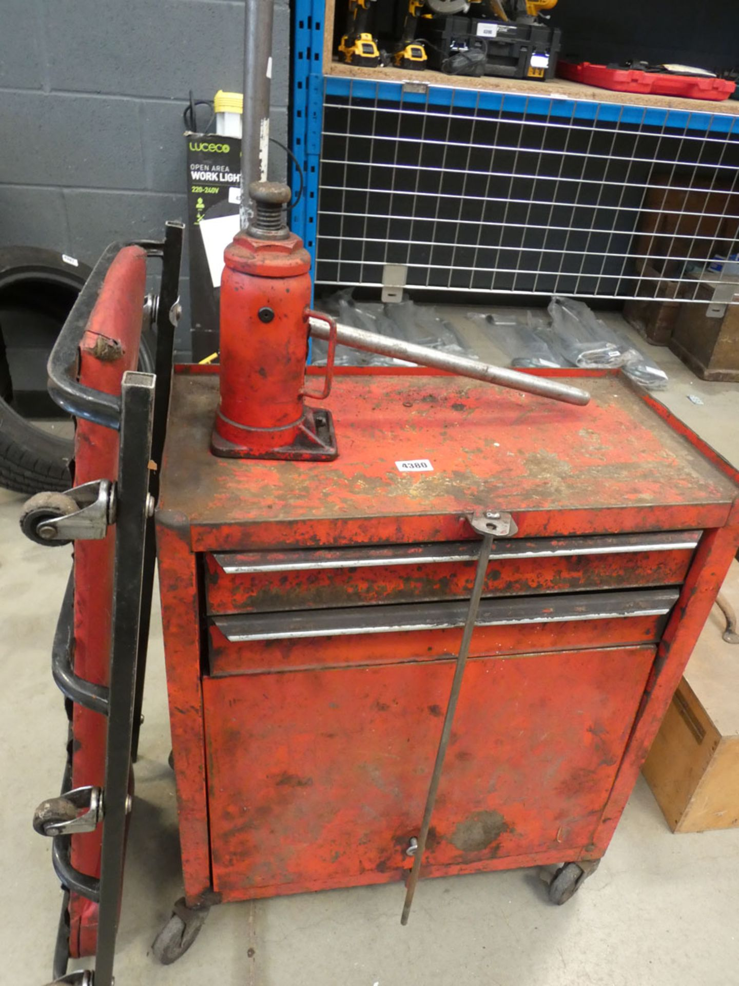 Red 4 wheeled toolbox, bottle jack, trolley jack and a mechanics creeper board - Image 2 of 3
