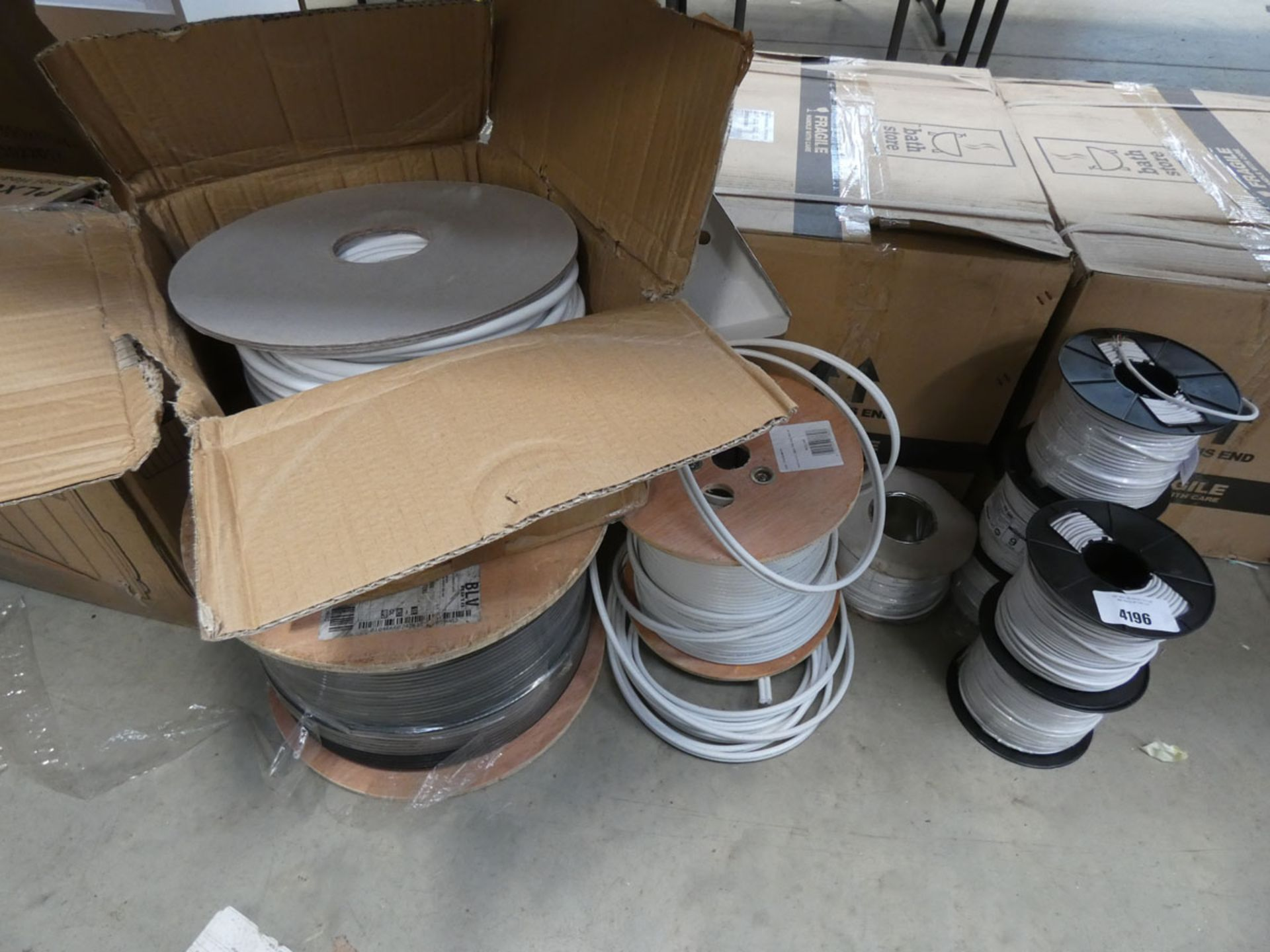 7 rolls of speaker cable and quantity of white and black cable