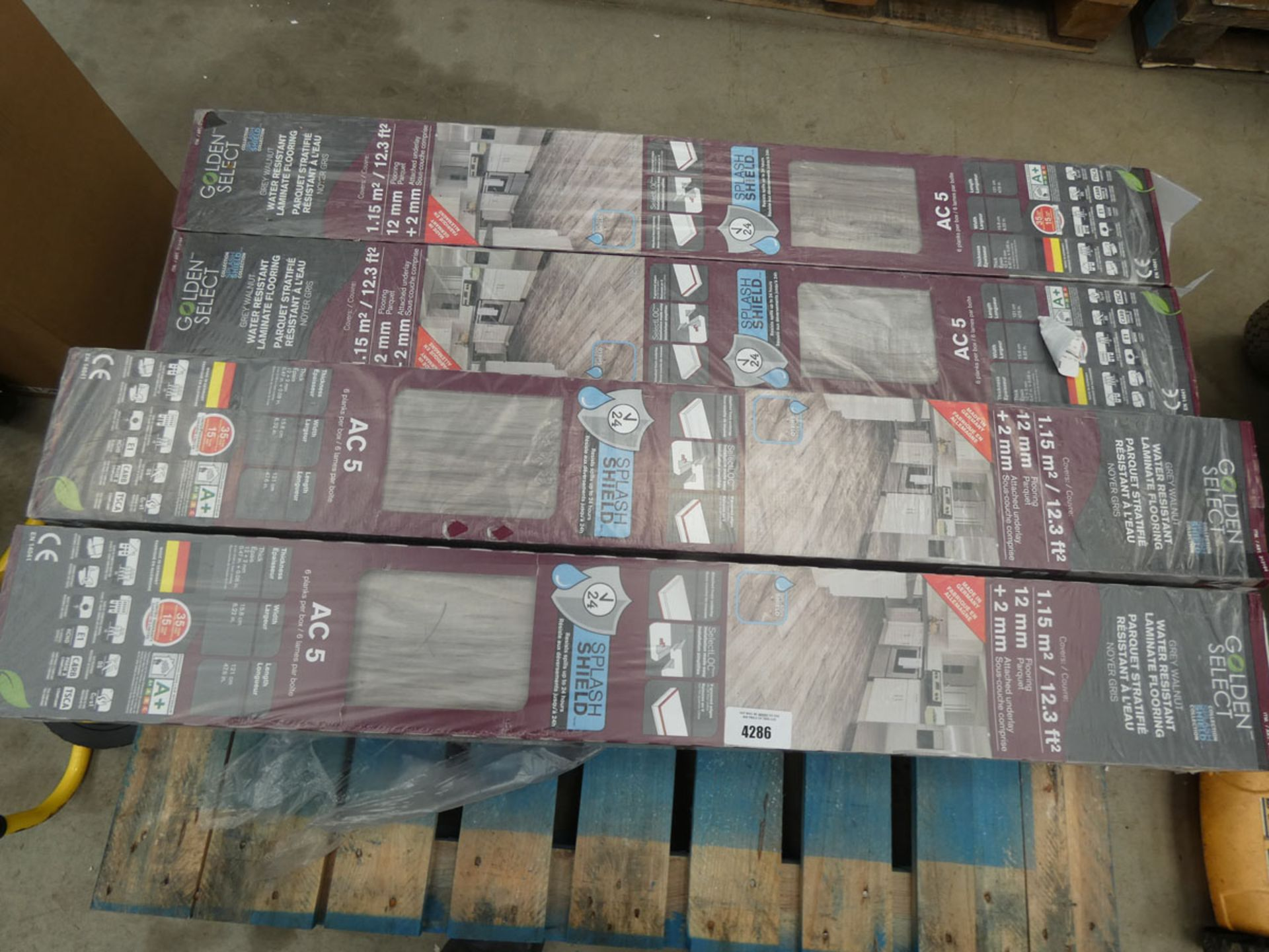 9 packs of Golden Select grey walnut colour laminate flooring Possibly faulty