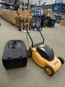 Small yellow electric mower, no grass box