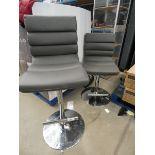 2 grey chrome based bar stools