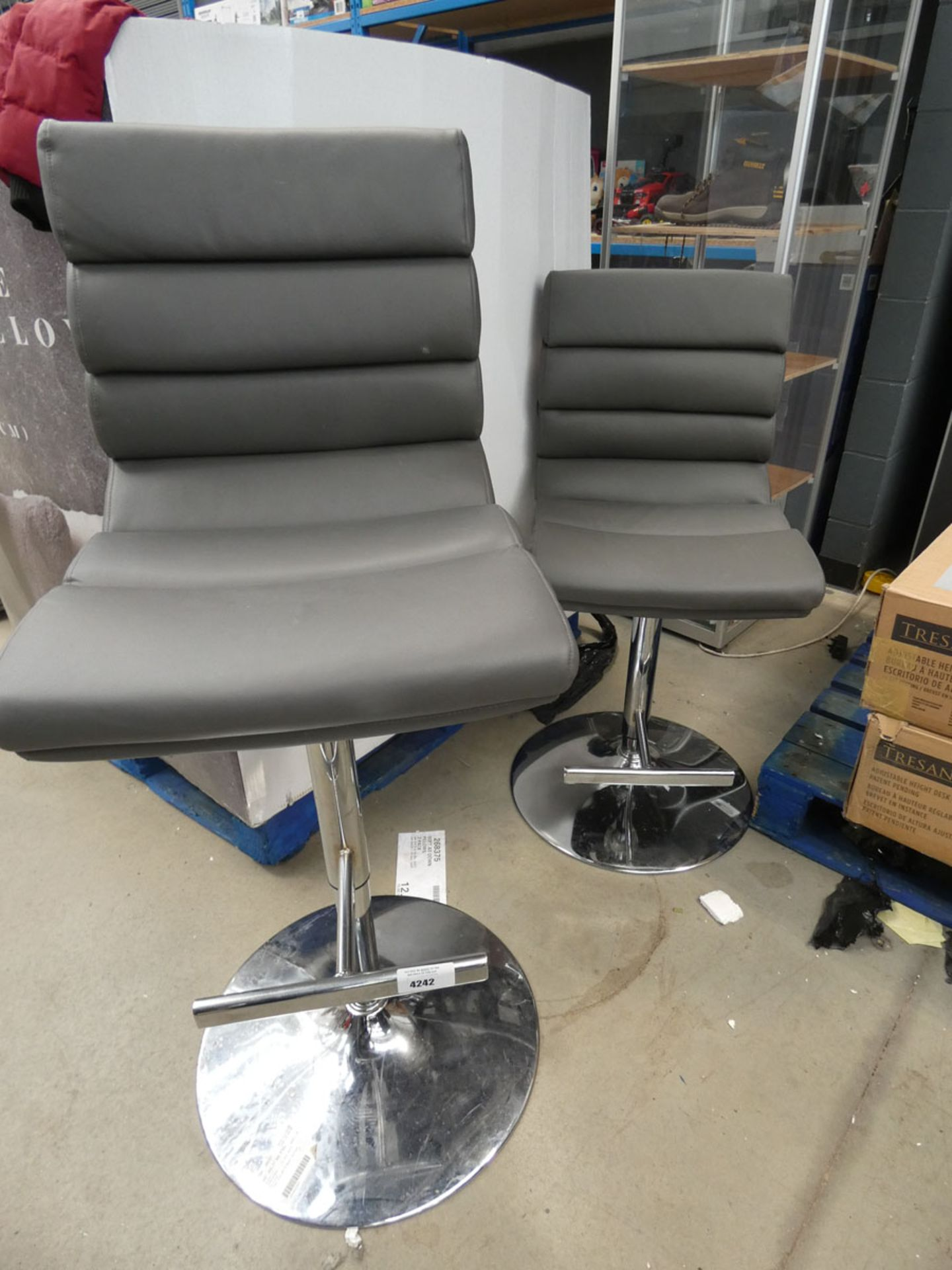 2 grey chrome based bar stools