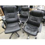 3 black highback swivel armchairs