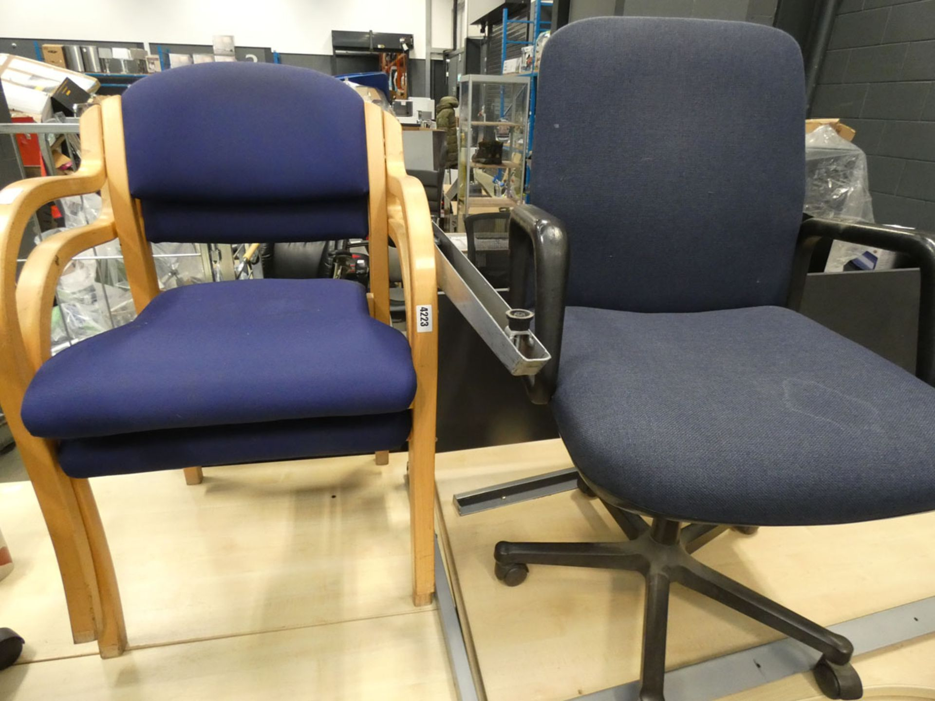 2 blue cloth wooden frame stacking chairs