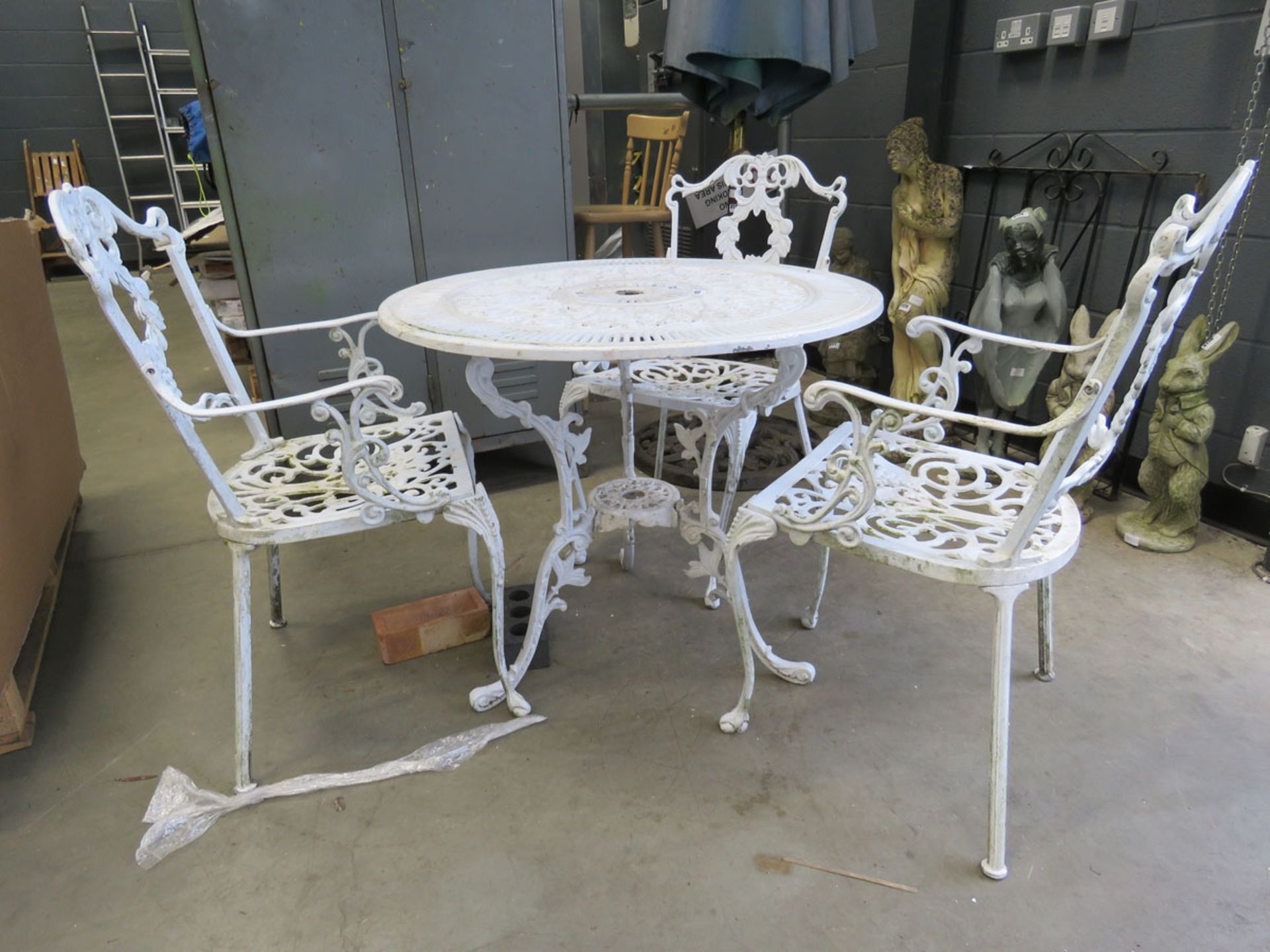 Metal round white garden table and 3 matching armchairs
