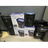 3 boxed and 5 unboxed paper shredders