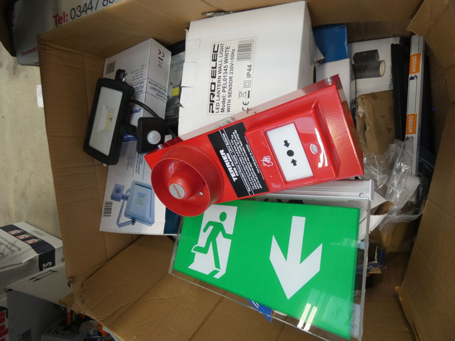 Box of floodlights, exit signs, and switches
