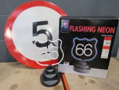 5mph sign and flashing neon Route 66 sign