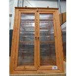Wooden and plastic garden cold frame