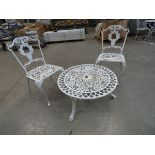 Low round metal garden table and 2 matching chairs